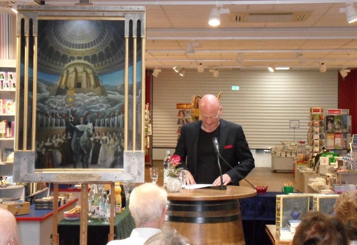 Dr. Uwe Brand beginnt als 1. Autor die Lesung
